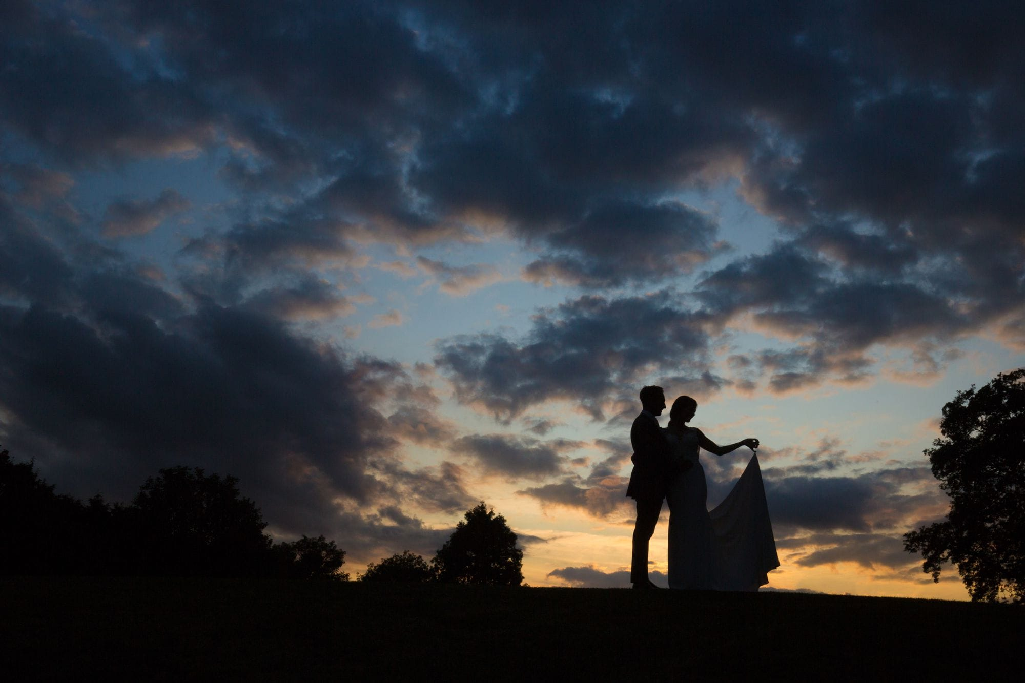 Silhoutte image of bride & groom